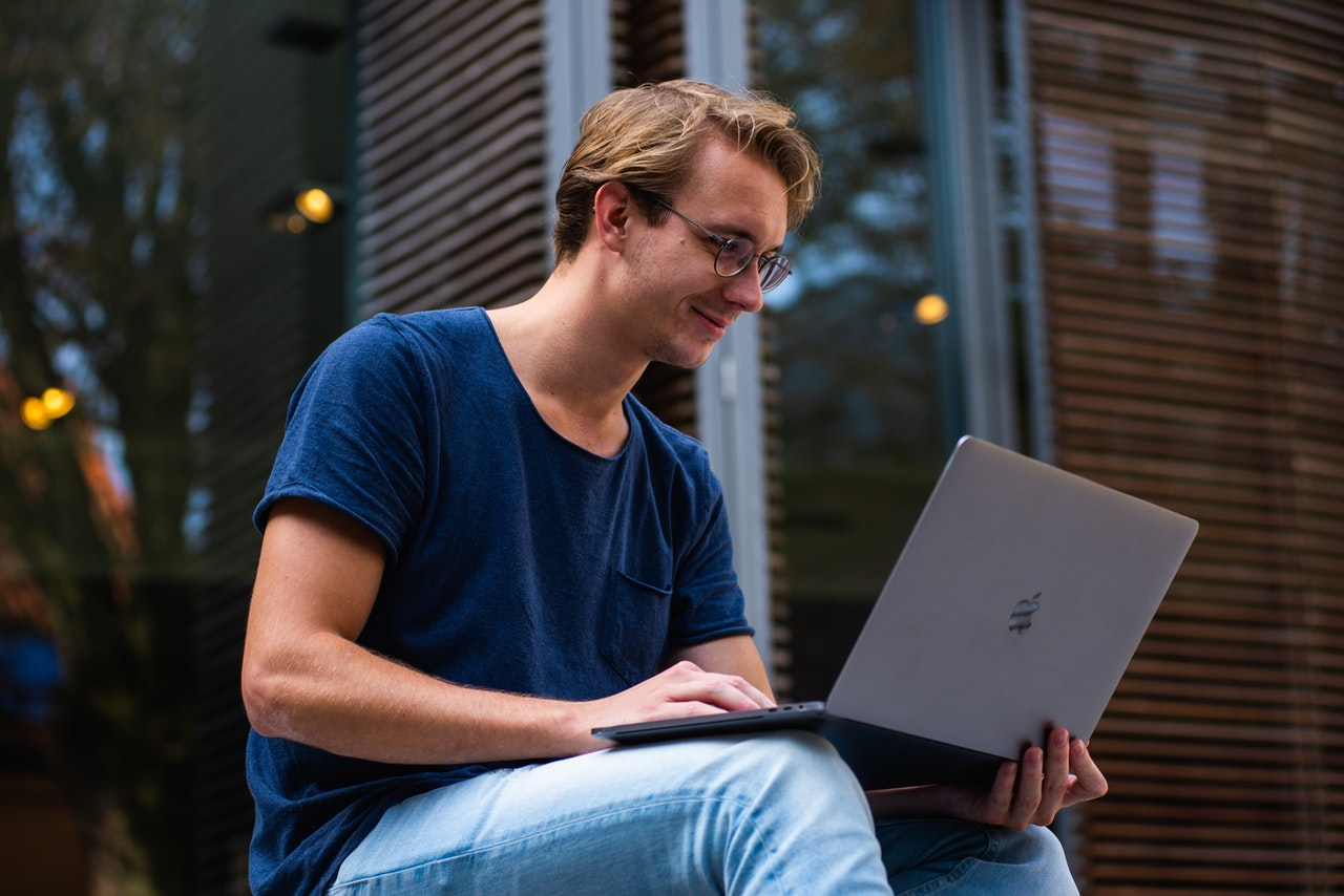 selective-focus-photo-of-man-using-laptop-1438081